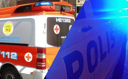 Ambulanssi ja poliisi hälytysvaloissa.